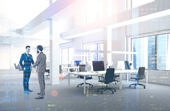 Businessmen in industrial style office royalty free stock photography