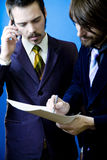 Businessmen inking a deal Stock Photo