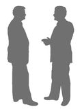 Businessmen - Isolated. Isolated silhouettes of 2 businessmen in discussion royalty free illustration