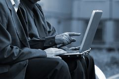 Businessmen with laptop Royalty Free Stock Photography