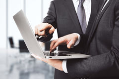 Businessmen with laptop in office Stock Images