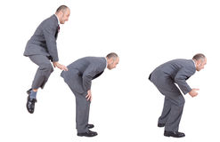 Businessmen leapfrogging competition Royalty Free Stock Photos