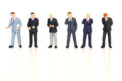 Businessmen lined up. And working as a team royalty free stock photo