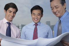 Businessmen Looking At Blueprint Stock Photo