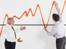 Businessmen Looking At Graph Royalty Free Stock Images