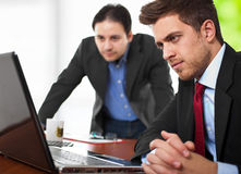 Businessmen looking at a laptop Royalty Free Stock Image