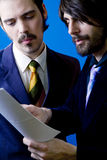 businessmen looking at papers Stock Photo