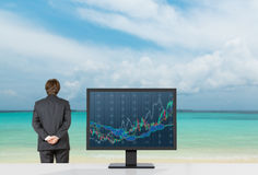 Businessmen looking to ocean Stock Images