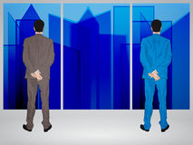 Businessmen looking through window Royalty Free Stock Photography