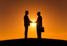 Businessmen Making Agreement during Sunset Royalty Free Stock Images
