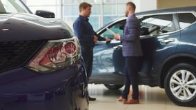 Businessmen is making a deal of buying a new car stock image