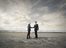 Businessmen making a deal Royalty Free Stock Image