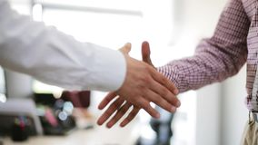 Businessmen making handshake at office stock footage