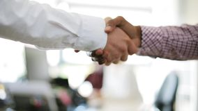 Businessmen making handshake at office stock video footage