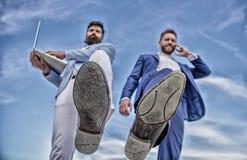 Businessmen making step bottom view. Business technologies coming. Big step for entrepreneurship. Smashing stock photography