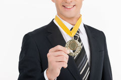 Businessmen with medal. Royalty Free Stock Photo