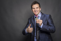 Businessmen with medal Stock Photos