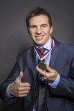 Businessmen with medal Stock Photography