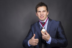 Businessmen with medal Royalty Free Stock Images