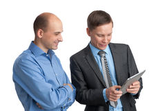 Businessmen Meeting And Looking At Tablet Computer Stock Image