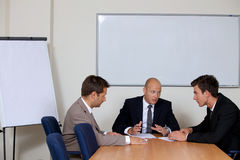 Businessmen in meeting at board room Royalty Free Stock Photography