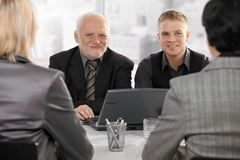 Businessmen meeting with businesswomen Royalty Free Stock Photos