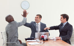 Businessmen in a meeting celebrating a success Royalty Free Stock Images