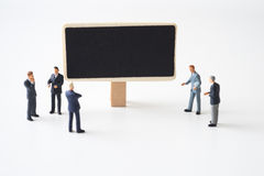 Businessmen meeting at chalkboard Stock Photos