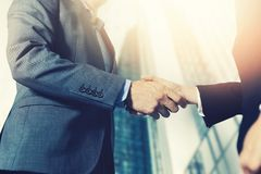 Businessmen meeting and handshake in front of business center Royalty Free Stock Image