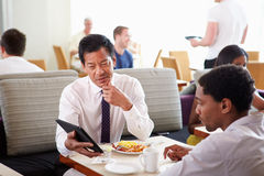 Businessmen Meeting Over Breakfast In Hotel Restaurant Royalty Free Stock Photo