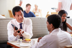 Businessmen Meeting Over Breakfast In Hotel Restaurant Stock Photos
