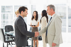 Businessmen meeting and shaking hands Stock Image