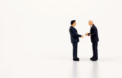 Businessmen miniatures agreeing Royalty Free Stock Photos