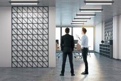 Businessmen in modern office stock photos