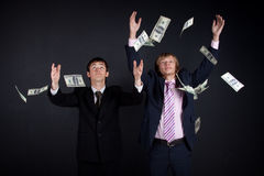 Businessmen and money. Royalty Free Stock Photos