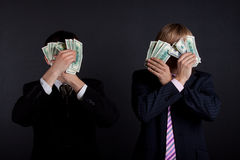Businessmen and money. Stock Photos