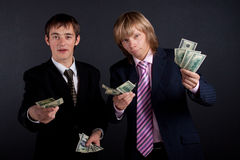 Businessmen and money. Stock Images