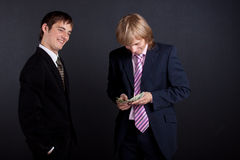 Businessmen and money. Royalty Free Stock Photography