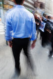 Businessmen on the move in the city Stock Image