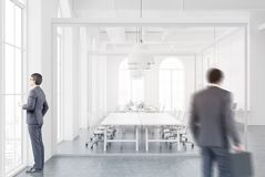 White and glass office, meeting room, people Royalty Free Stock Photography
