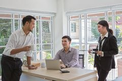 Businessmen are negotiating business. Group of three business. People discussing the deal. Business people during a meeting in the royalty free stock image
