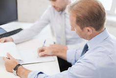 Businessmen with notebook on meeting Stock Images