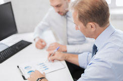 Businessmen with notebook on meeting Royalty Free Stock Image