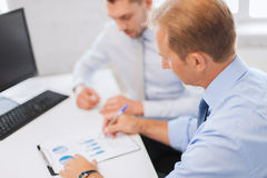 Businessmen with notebook on meeting Stock Photography
