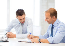 Businessmen with notebook on meeting Stock Image