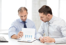 Businessmen with notebook on meeting Stock Photo