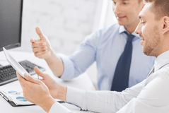 Businessmen with notebook and tablet pc Stock Photography