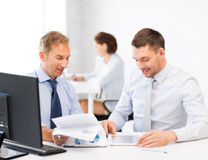 Businessmen with notebook and tablet pc Royalty Free Stock Photos