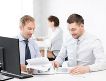 Businessmen with notebook and tablet pc Royalty Free Stock Image