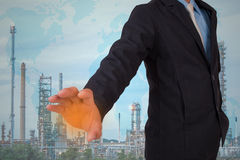 Businessmen with oil refinery Royalty Free Stock Photos